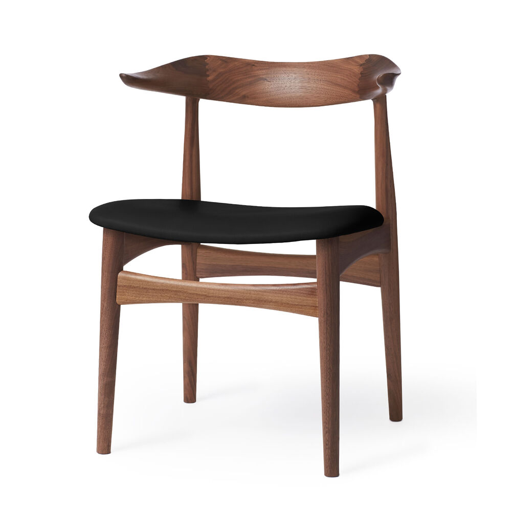 Cow horn dining chair in walnut and black leather