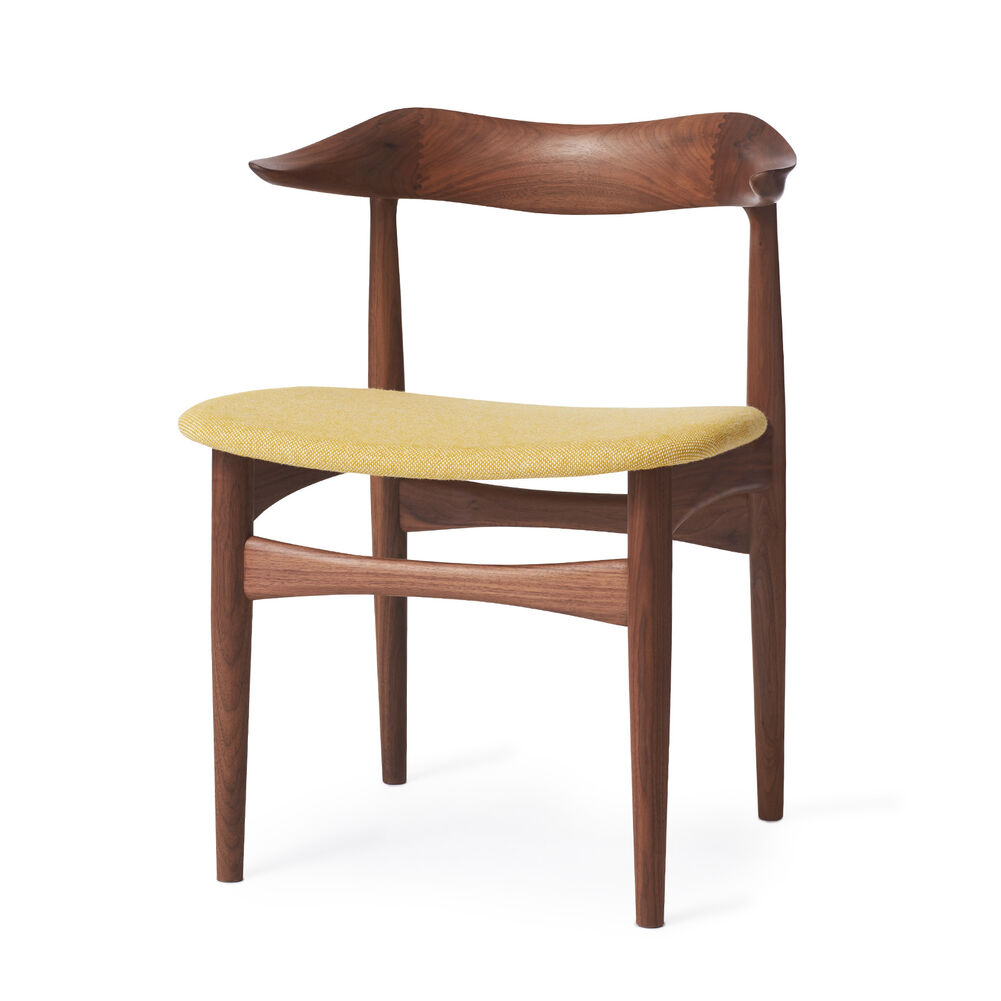 Cow horn dining chair in walnut and yellow textile