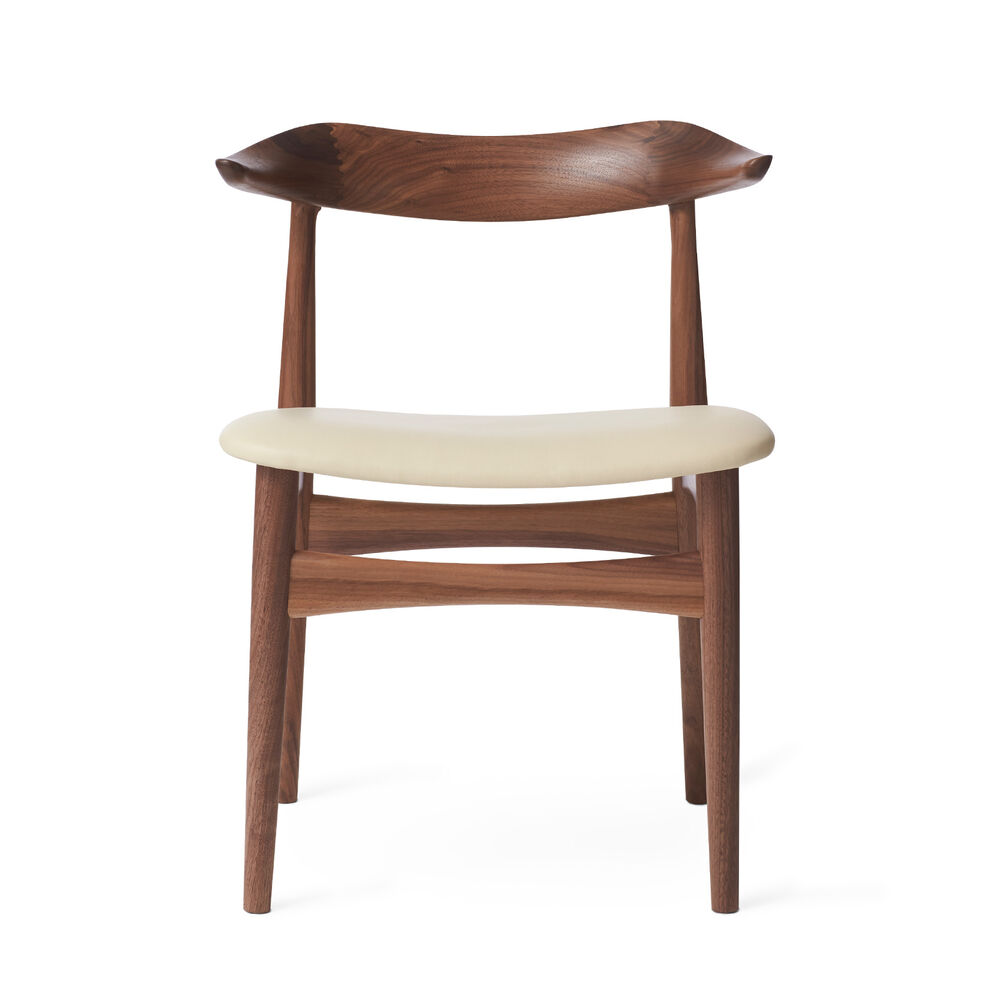 Cow horn dining chair in walnut and ivory leather