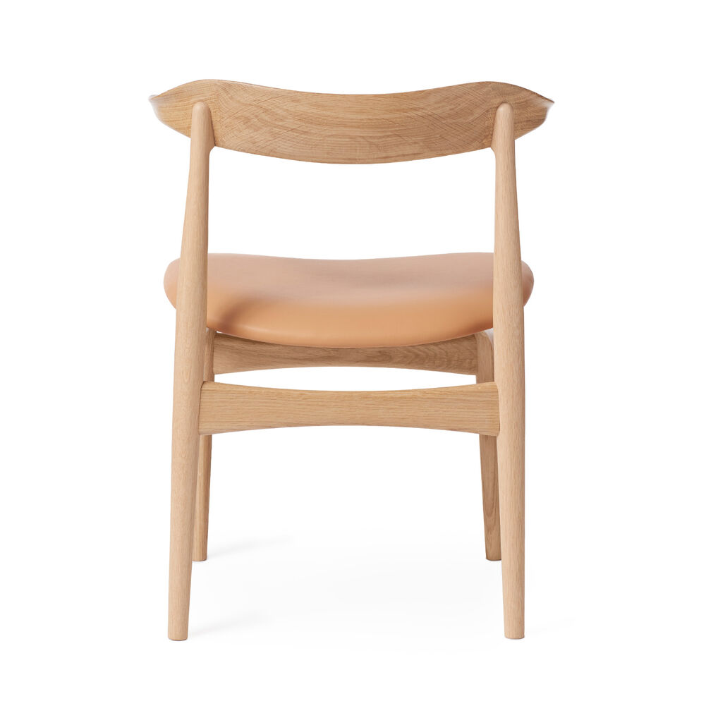 Cow Horn dining chair in oak and nature leather