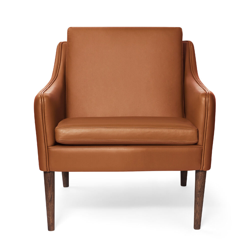 Mr. Olsen lounge chair in cognac leather and legs in smoked oak.