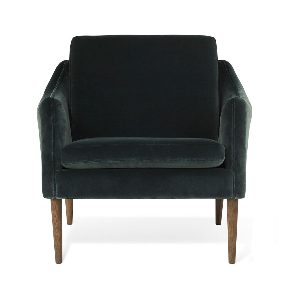 Mr. Olsen lounge chair in dark petrol velvet with legs in smoked oak.
