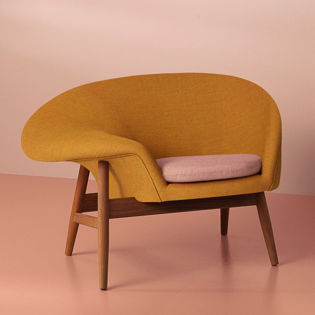 Fried Egg lounge chair in dark ochre yellow and pale rose.