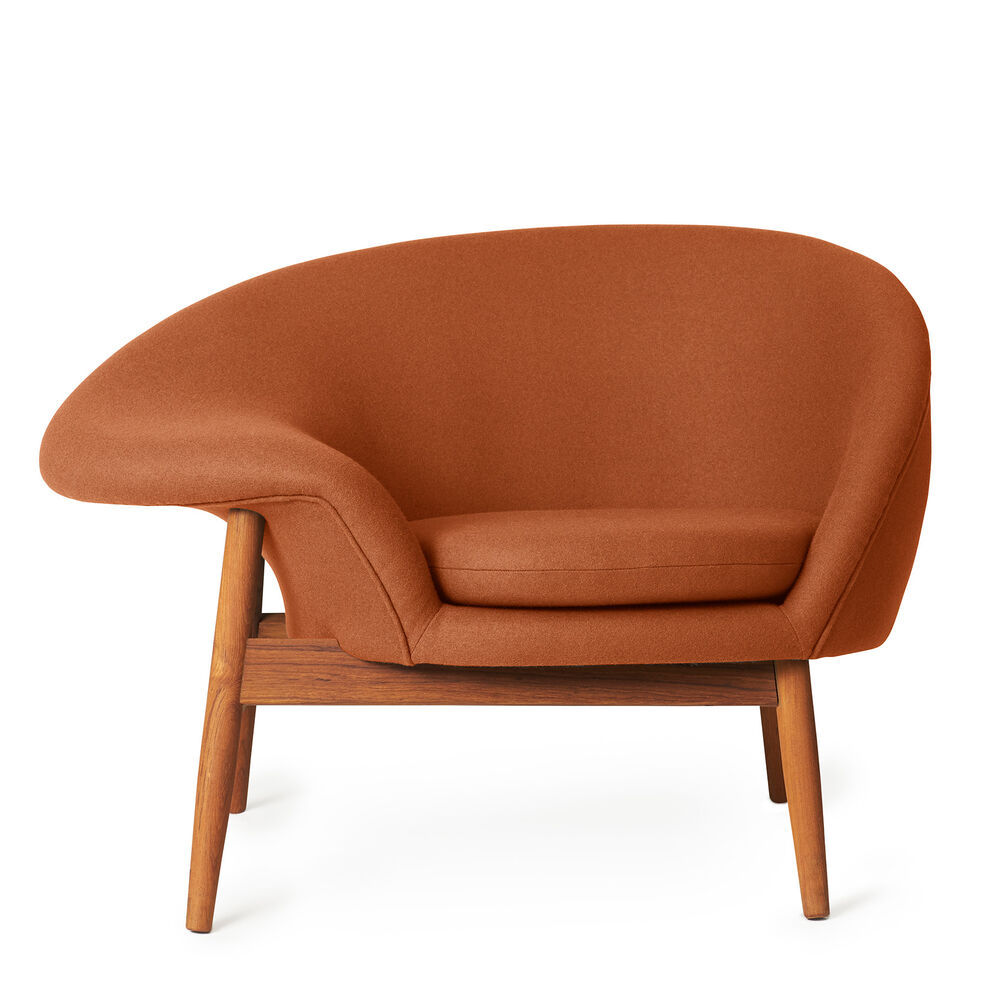 Fried Egg lounge chair in caramel brown colour.