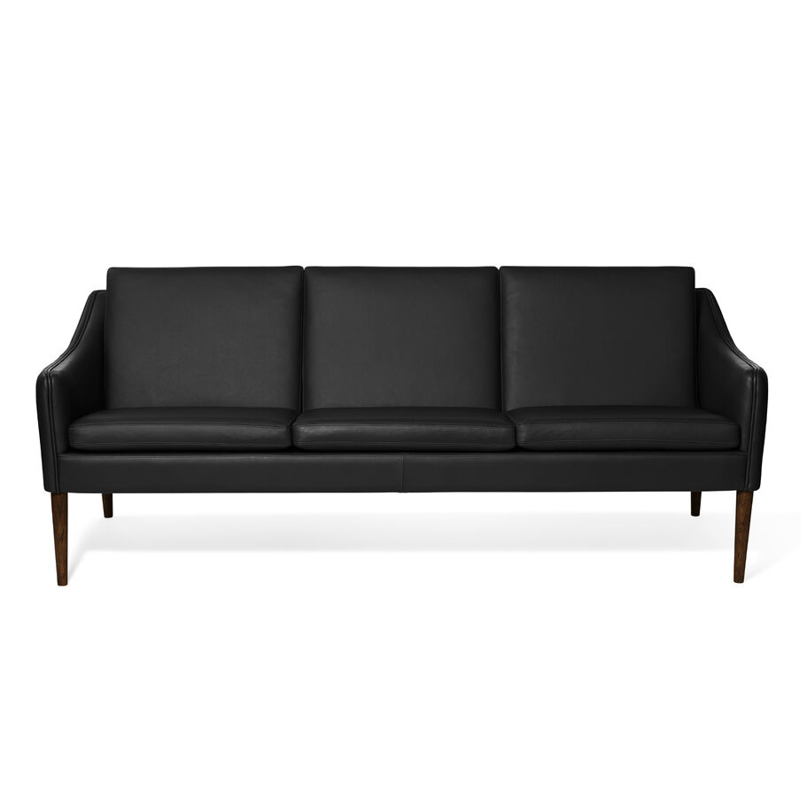 Mr. Olsen sofa in black leather with legs in walnut oiled oak.
