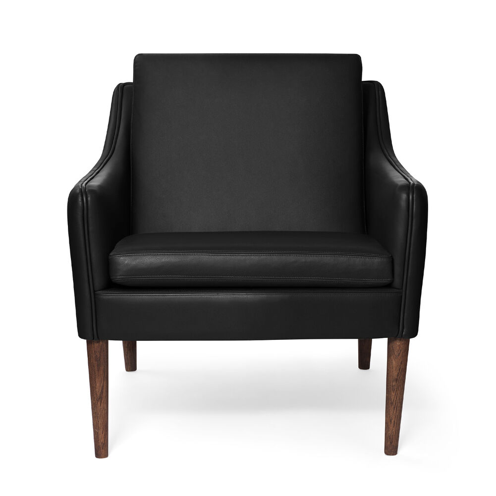 Mr. Olsen lounge chair in black challenger leather with legs in smoked oak.