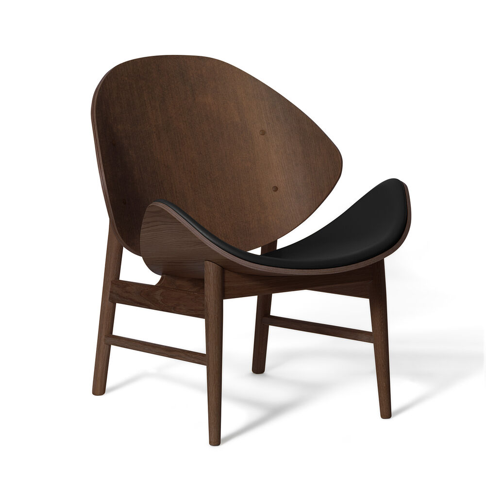 The orange lounge chair in smoked oak and seat in black leather