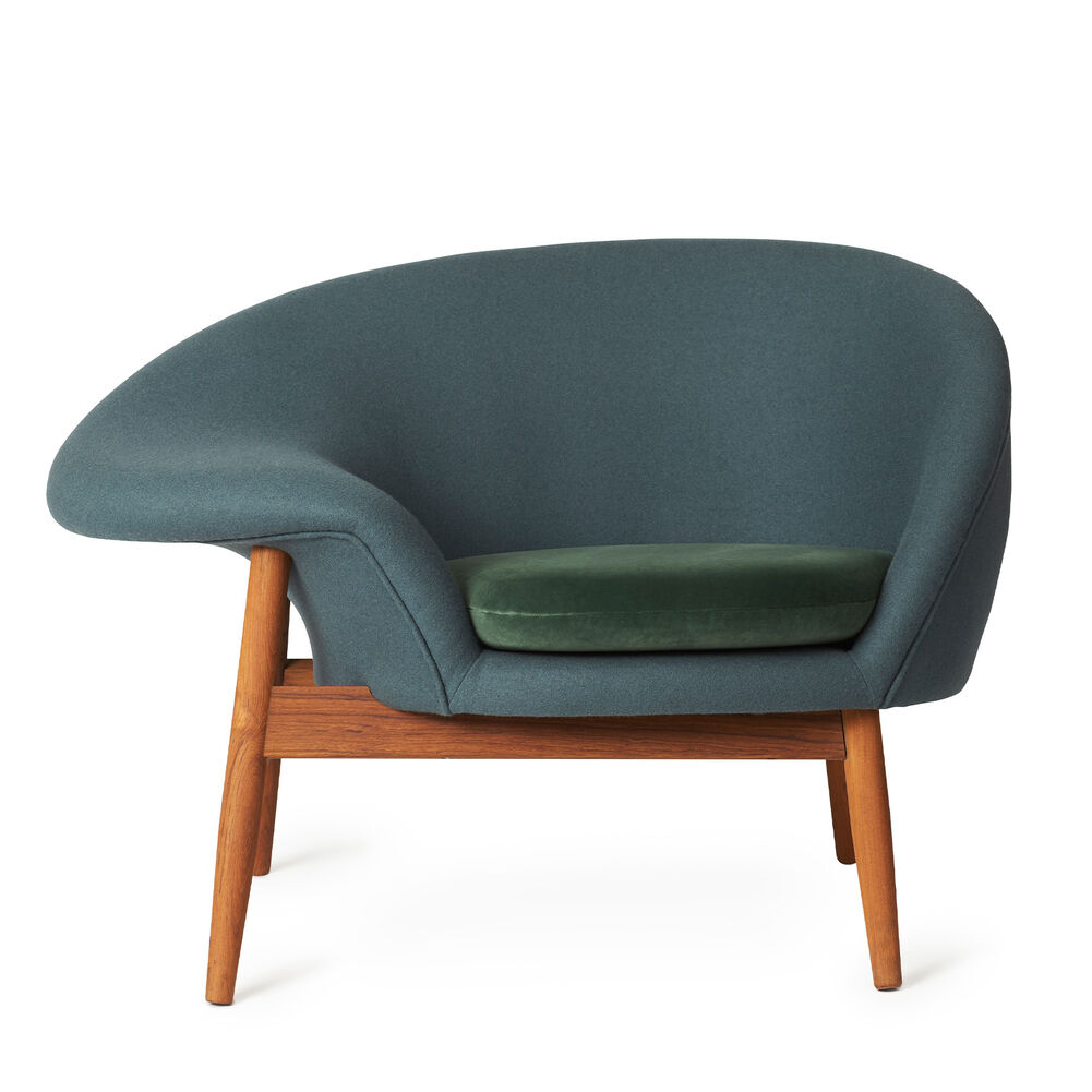 Fried Egg chair in blue petrol with green velvet cushion.
