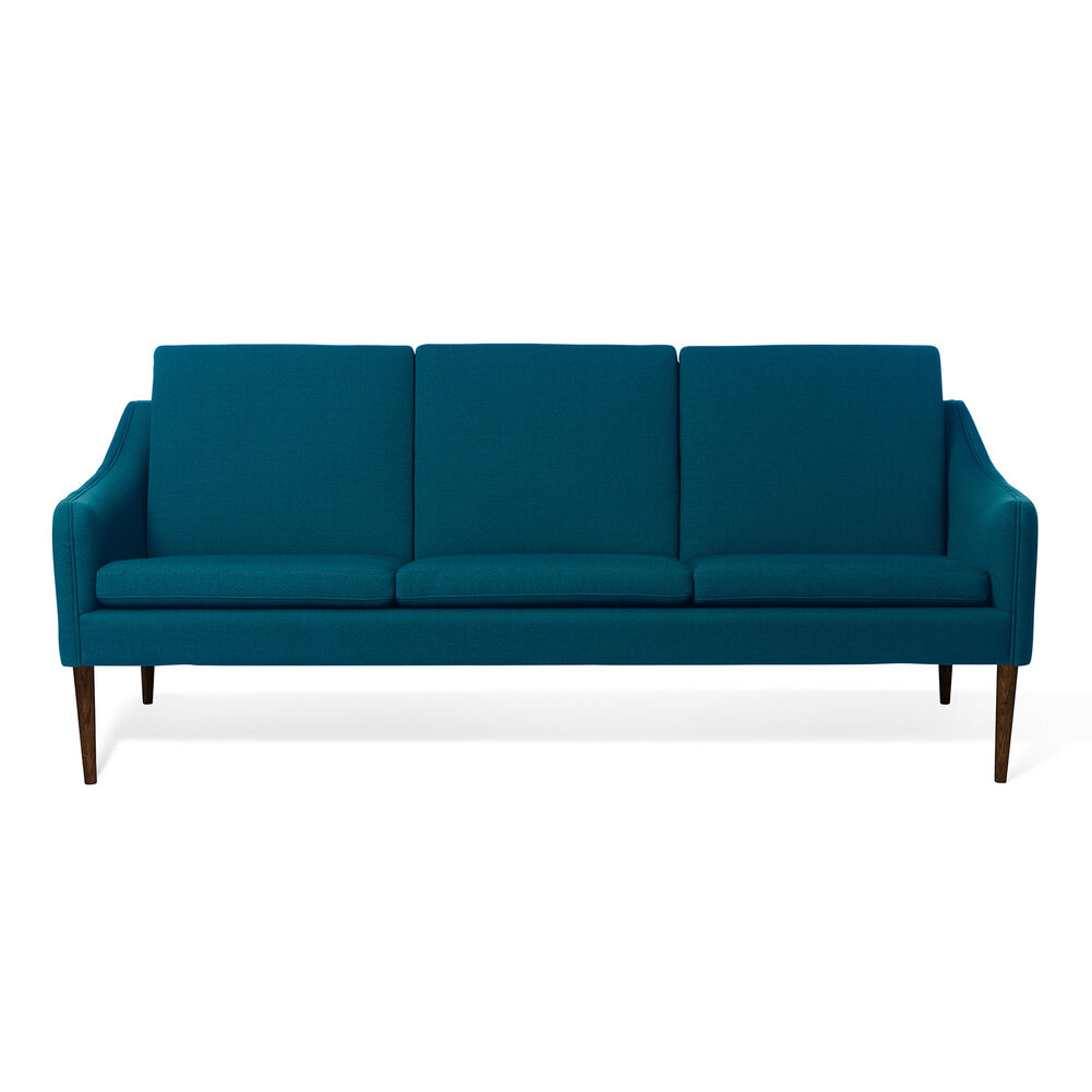 Mr. Olsen sofa in dark turqouise with legs in walnut oiled oak.