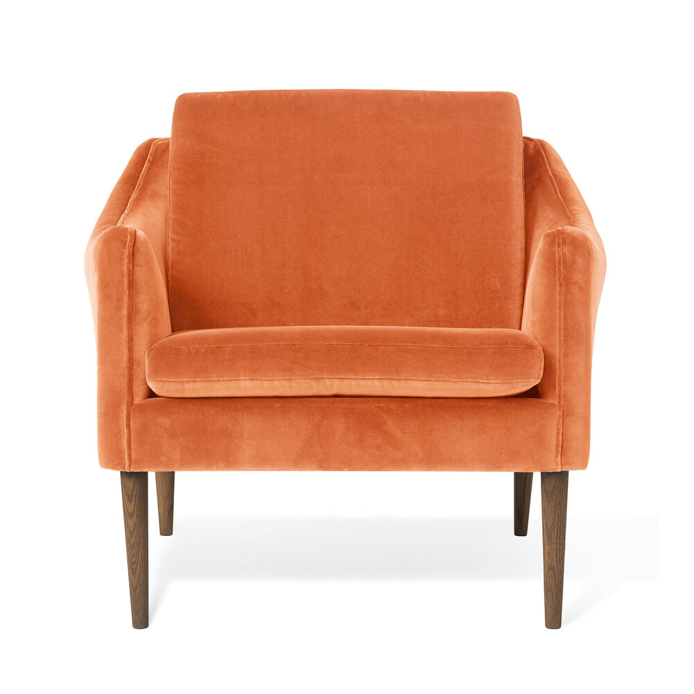 Mr. Olsen lounge chair in rusty rose velvet with legs in smoked oak.