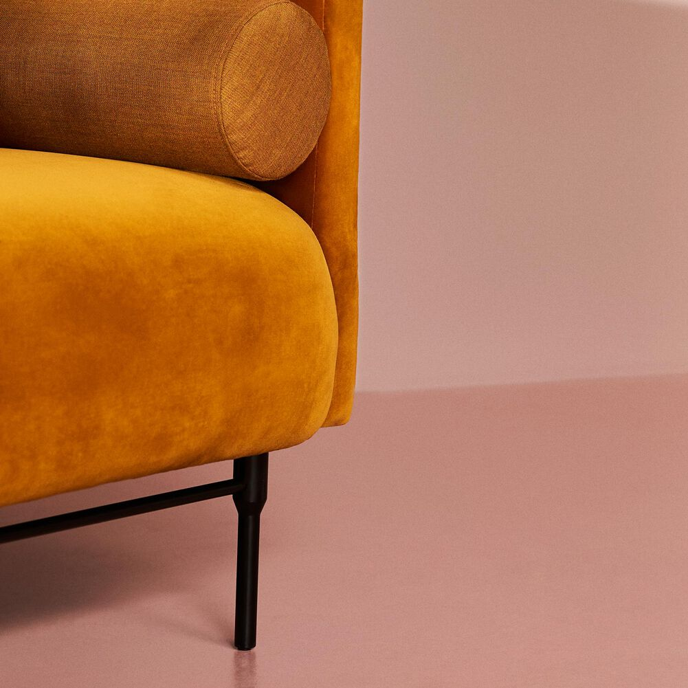 Close-up of Galore sofa, 3 seater in amber velvet.