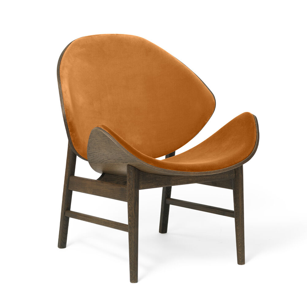 The orange lounge chair in smoked oak and amber velvet colour