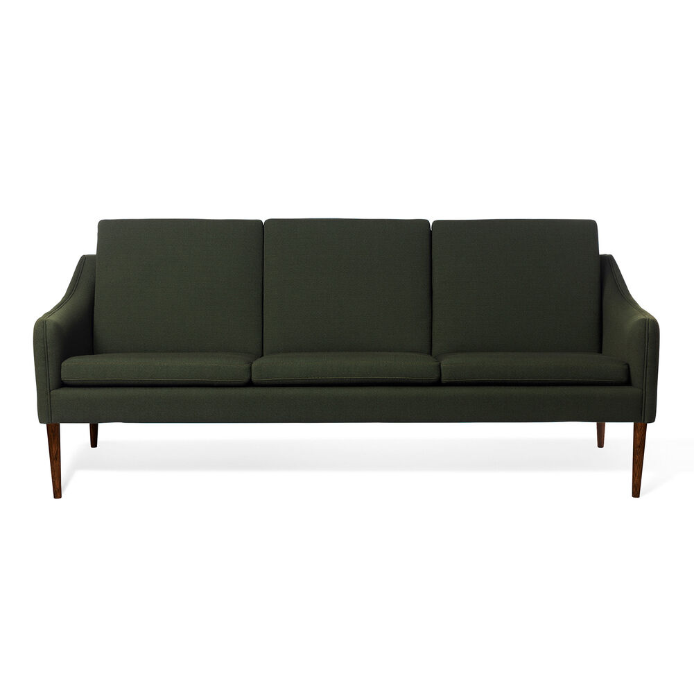 Mr. Olsen sofa in dark green with legs in walnut oiled oak.