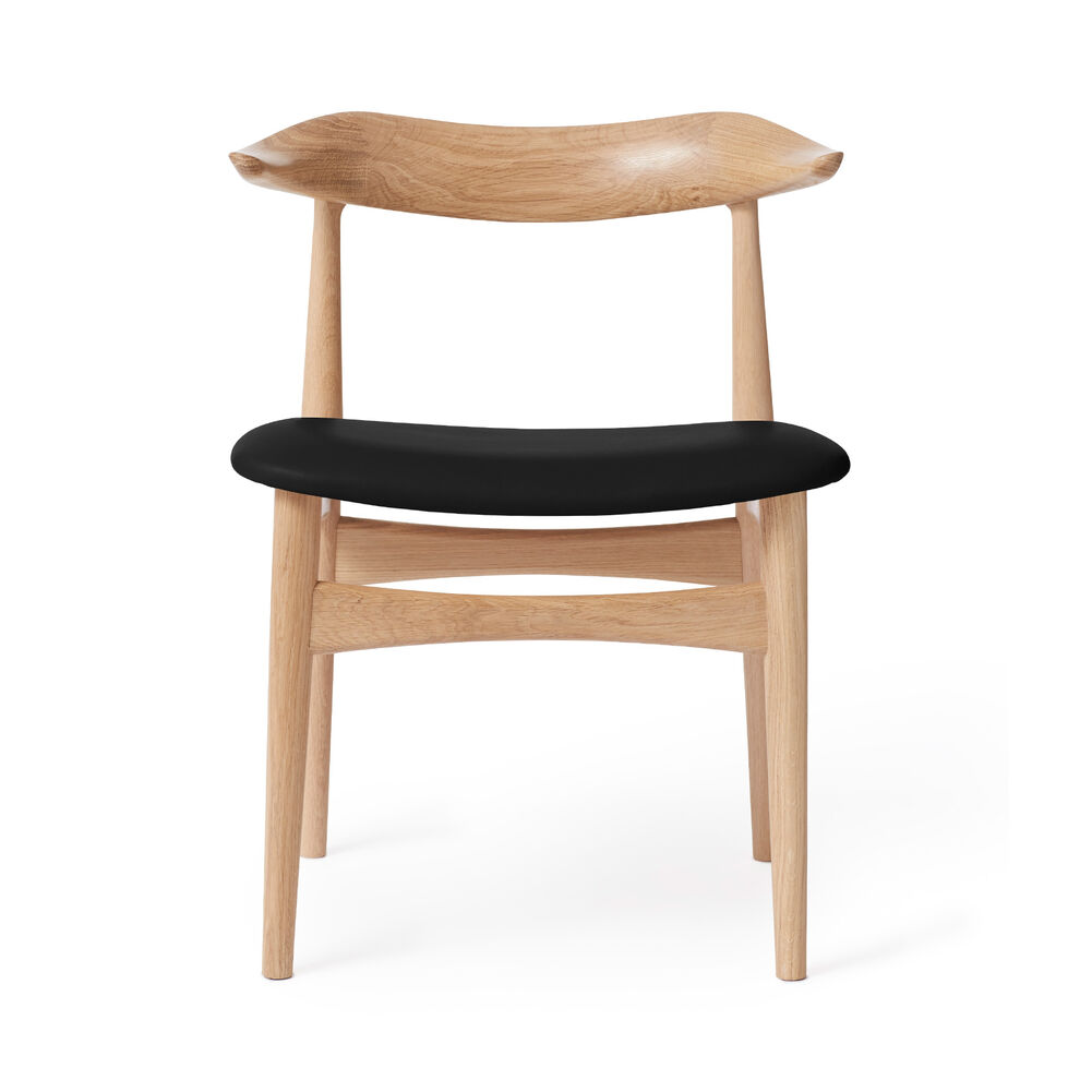 Cow Horn dining chair in oak and black leather