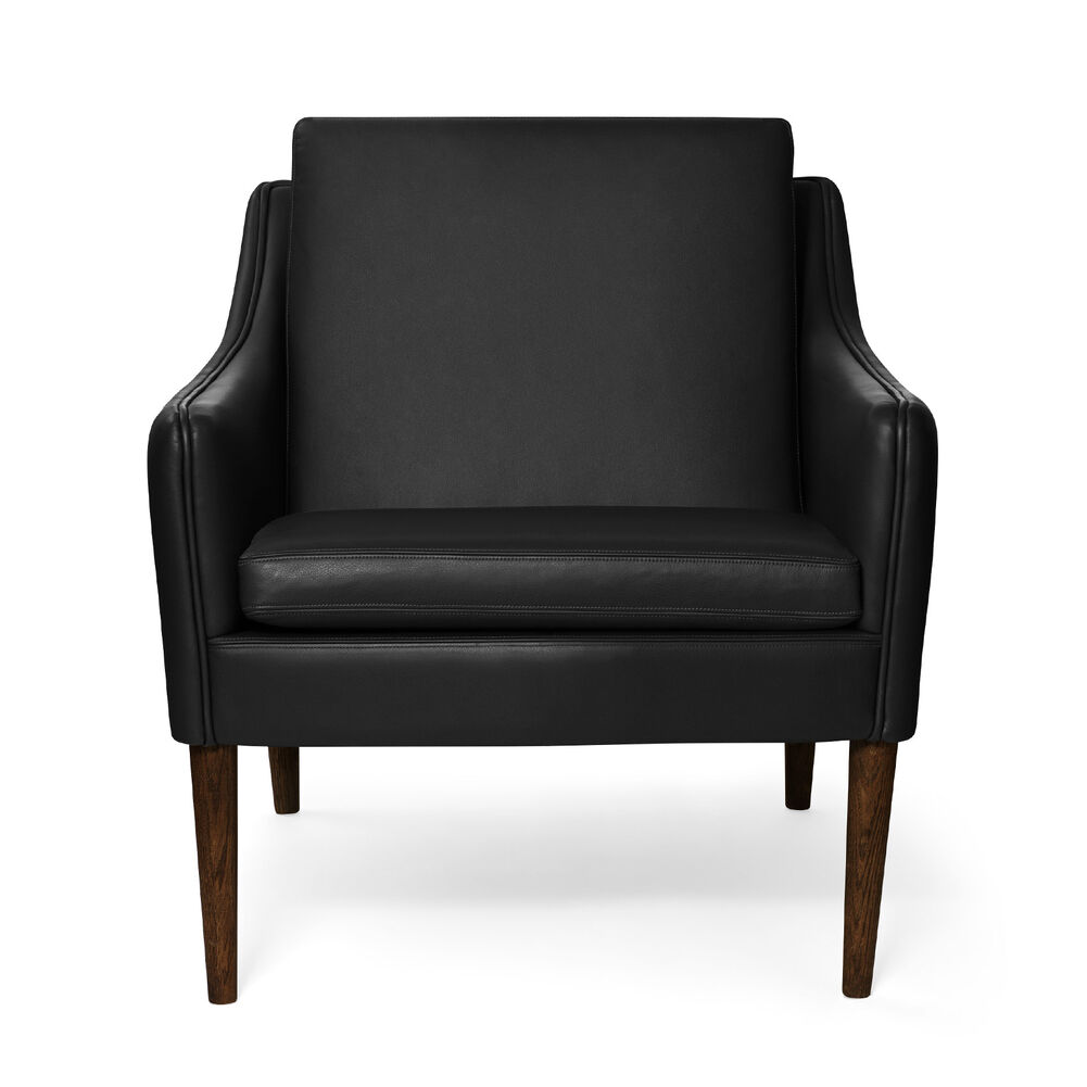 Mr. Olsen lounge chair in black challenger leather with legs in walnut oiled oak.