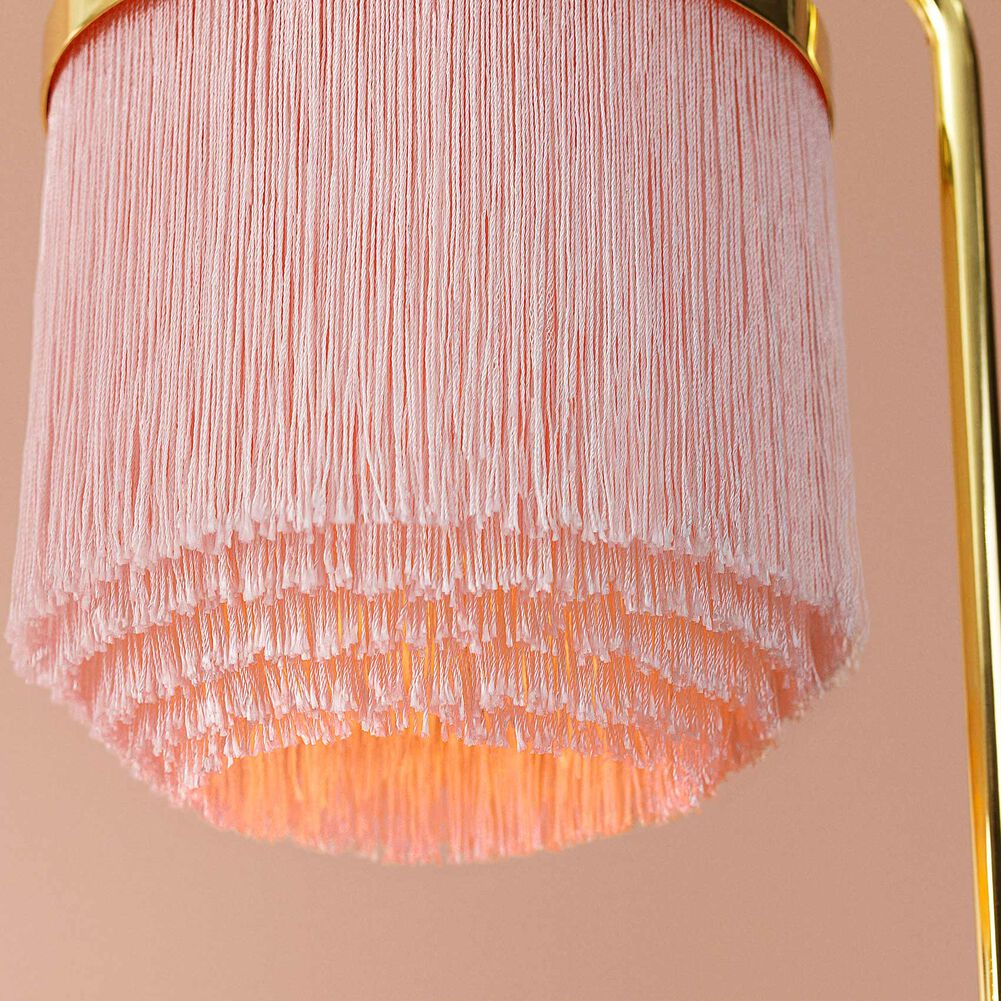 Details of fringe table lamp in pale pink colour