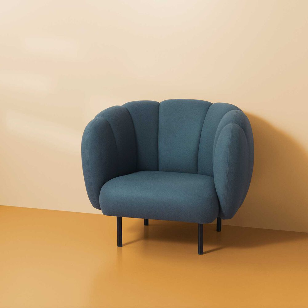 Cape lounge chair with stitches in petrol colour