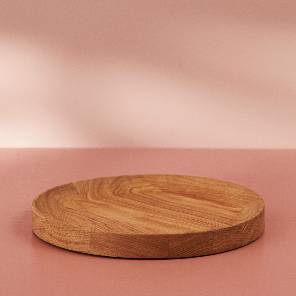 Round carved wood tray in oiled oak