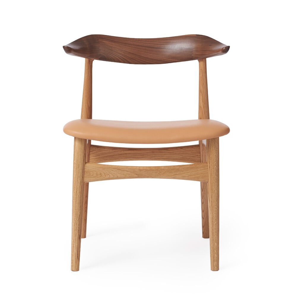 Cow Horn dining chair in walnut, oak and nature leather