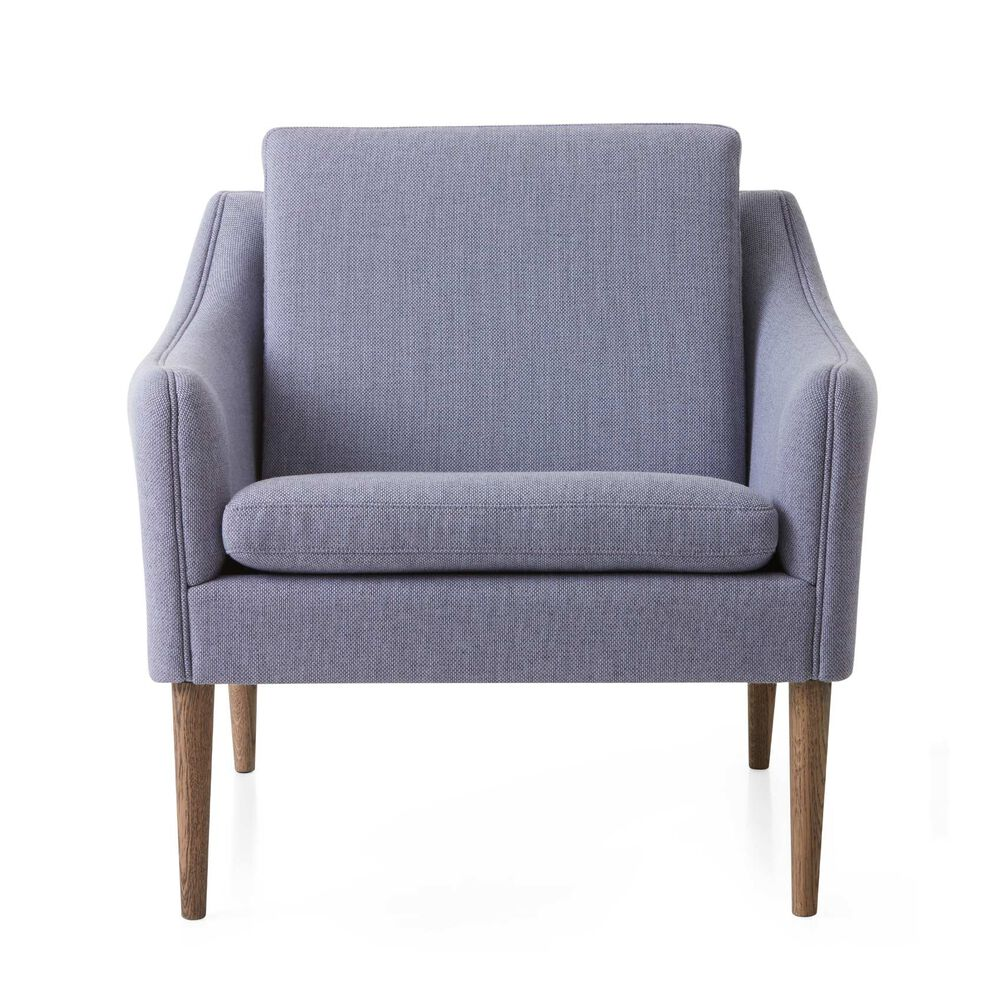 Mr. Olsen lounge chair in soft violet sustainable fabric with legs in smoked oak.