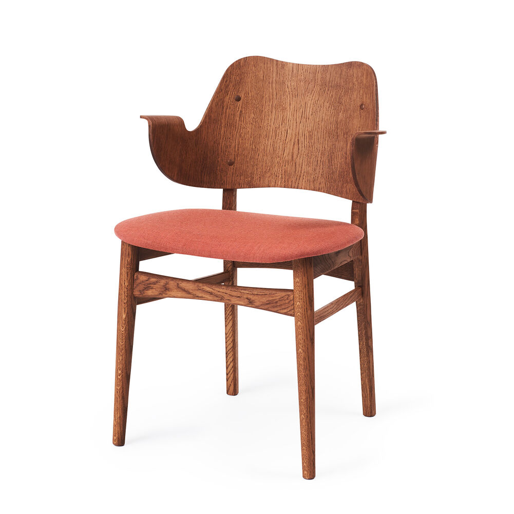 Gesture dining chair in teak and peachy pink seen from the side