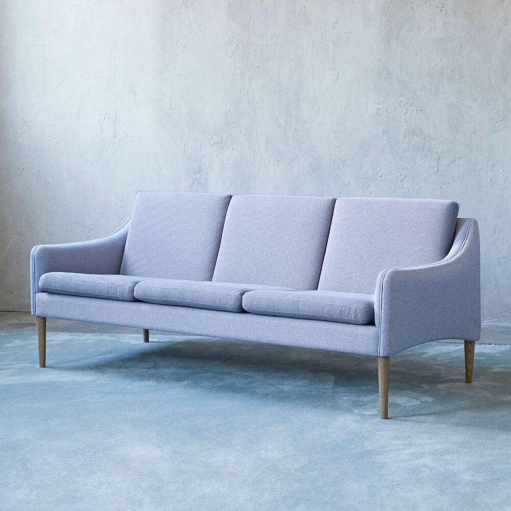 Mr. Olsen sofa in soft violet, sustainable fabric with legs in smoked oak.