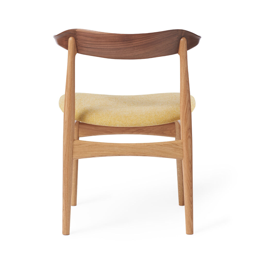Cow Horn dining chair in walnut, oak and vanilla textile