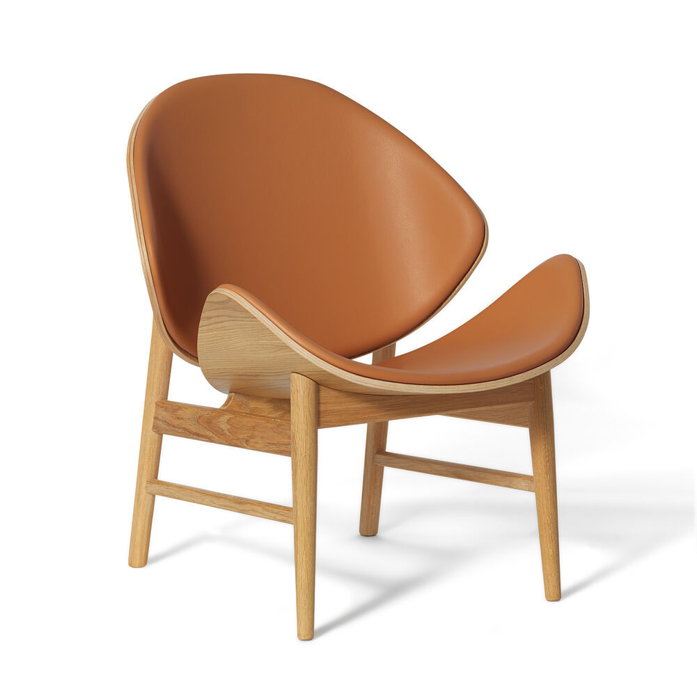 The orange lounge chair back and seat in cognac leather