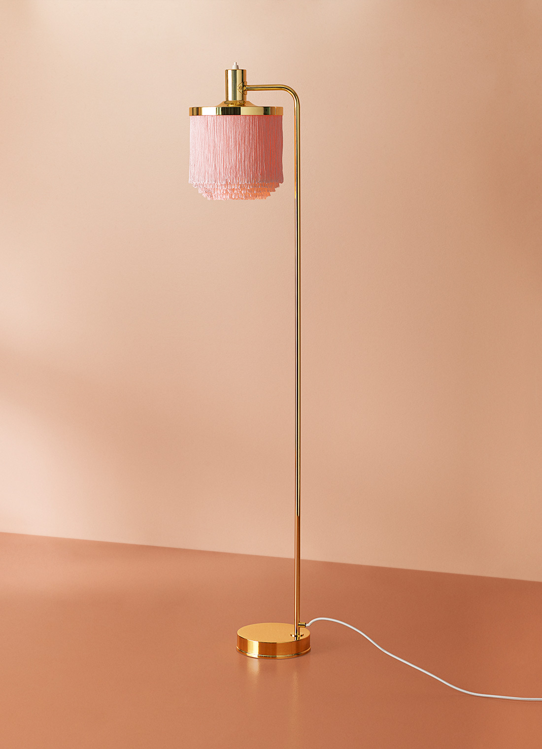 Fringe floor lamp in pale pink colour