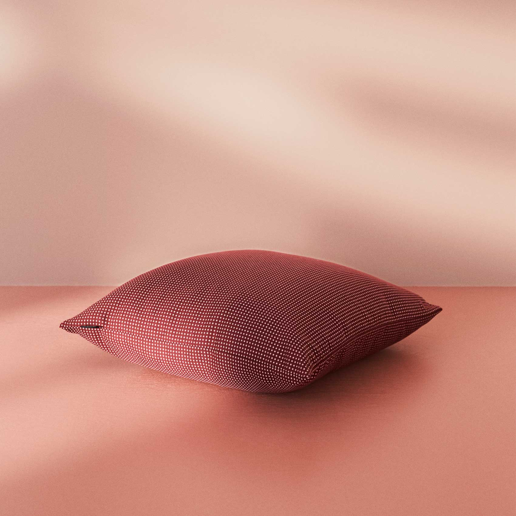 Warm Nordic cushion in bordeaux