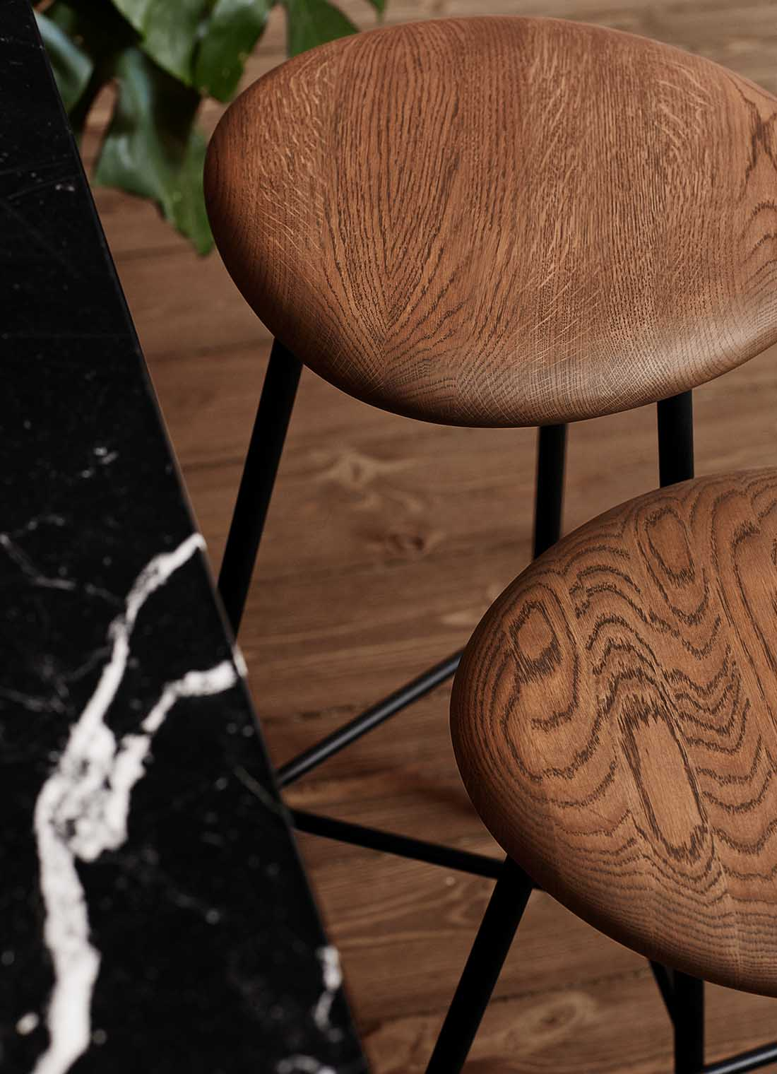 Pebble bar stools in smoked oak and black.