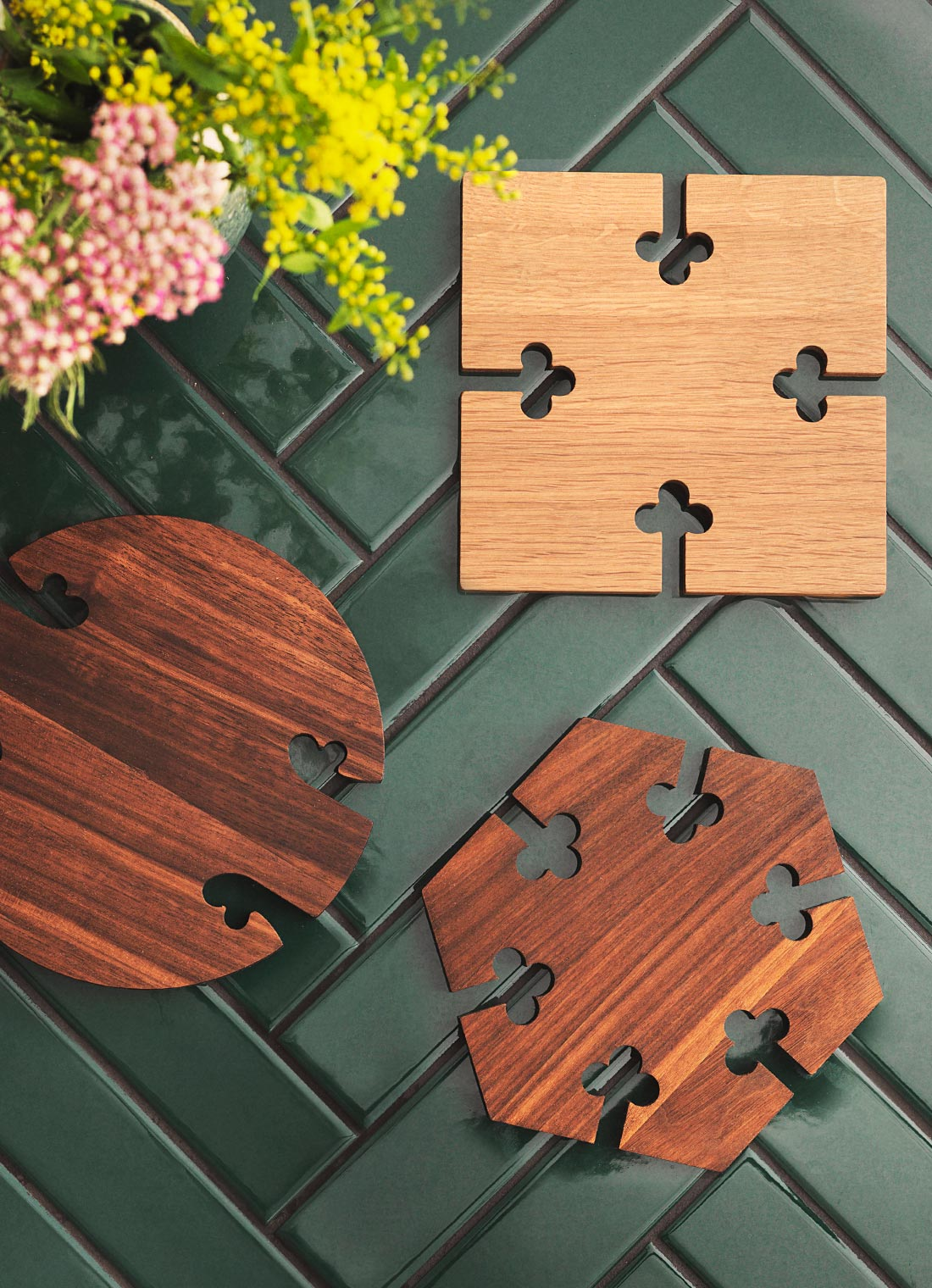 Gourmet wood trivets on a beatiful dining table