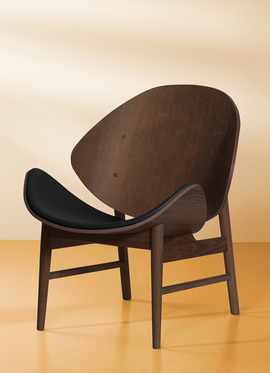 The orange lounge chair in smoked oak and black leather