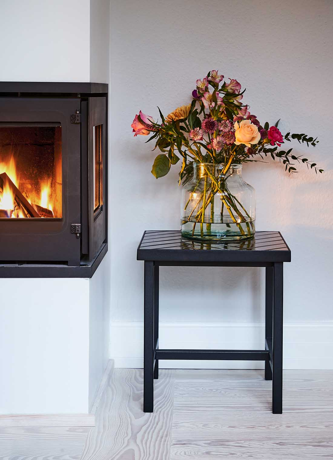 Herringbone Tile sidetable beside fireplace