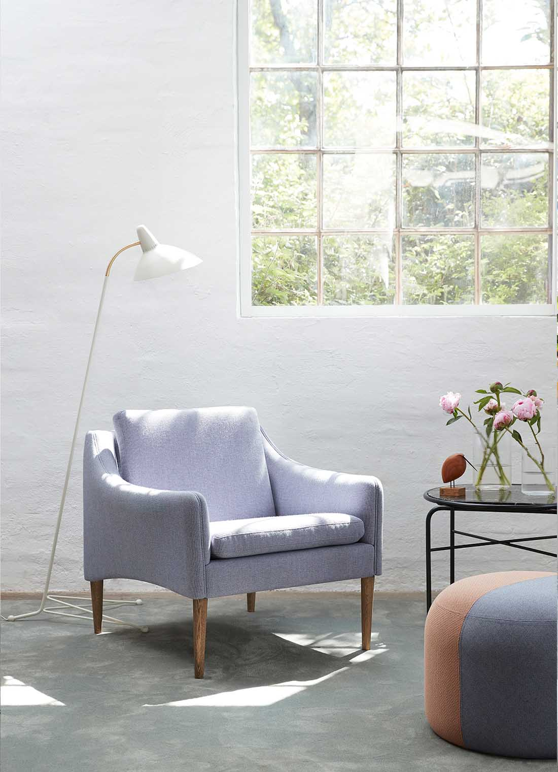 Mr. Olsen lounge chair in soft violet with a pouf.