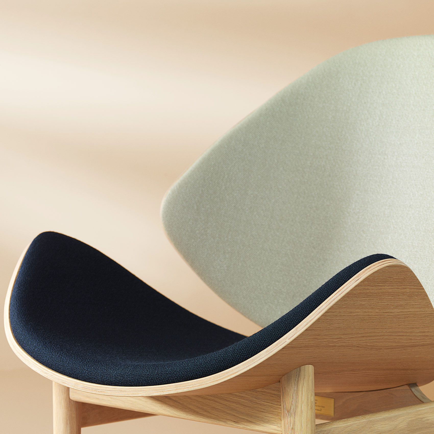The orange lounge chair in grey navy and blue colour