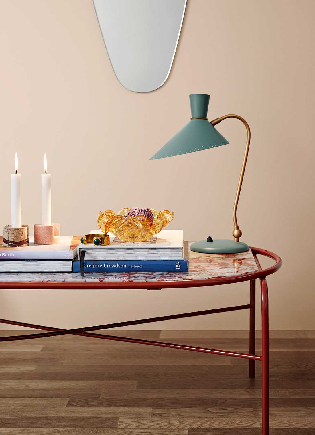 Secant coffee table  with a stylish table lamp and books.