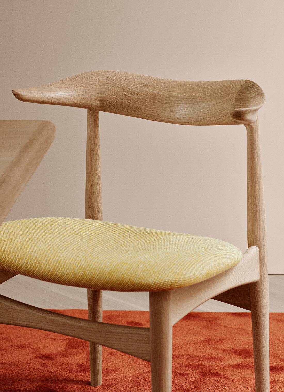Cow Horn dining chair in oak and yellow textile